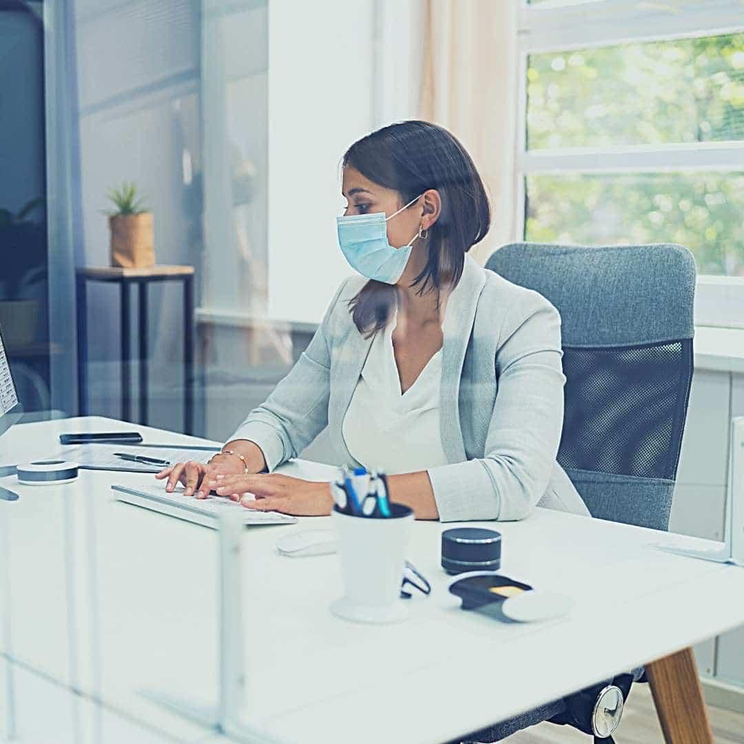 woman wearing mask covid-19 wells-riley risk hvac indoor kw engineering